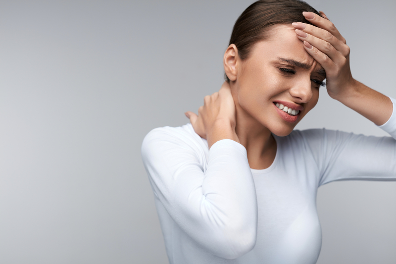 Woman with a headache and neck ache