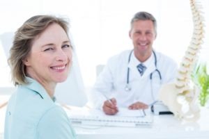 Patient meeting with a chiropractic doctor about their first chiropractic adjustment