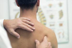 Chiropractor examining a patient's back