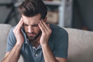 Man that is having headache or migraine pain