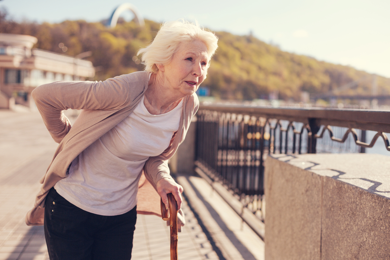 Older woman who is having lower back pain