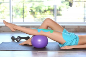 Woman doing physical therapy exercises to help a knee injury