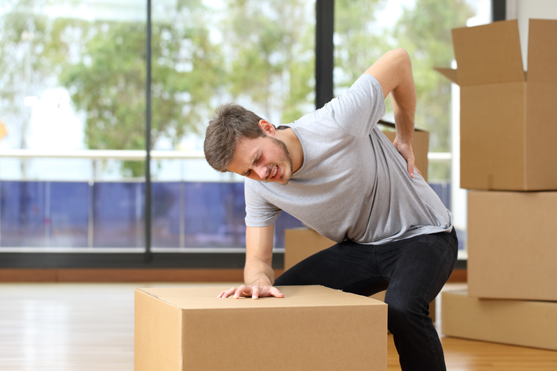 Man near boxes that has hurt his back