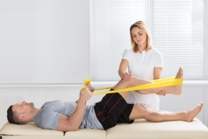 man receiving physical therapy for a hurt leg and knee