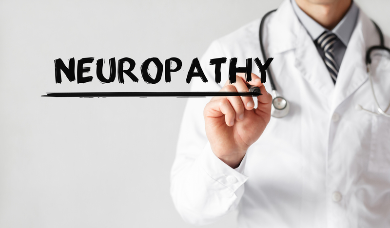 "A doctor writing the word ""neuropathy""."