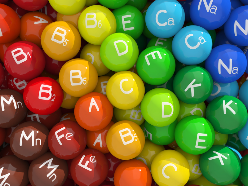Colorful balls that represent different vitamins and minerals the body needs.